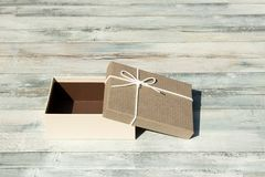 Greeting card. Opened Birthday gift box with white ribbon bow. P stock photo