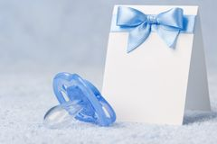 Greeting card with a pacifier Royalty Free Stock Image