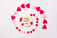 Greeting card with phrase. `HAPPY MOTHER`S DAY` and paper hearts on white background Royalty Free Stock Photography