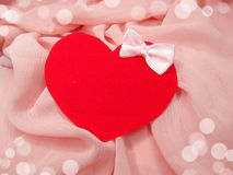 Greeting card on pink silk material and heart love concept Royalty Free Stock Photography