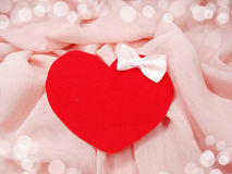 Greeting card on pink silk material and heart love concept Royalty Free Stock Image