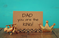 greeting card, plane toy and glitter king crown. Father& x27;s day concept Stock Photo