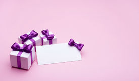 Greeting card and presents on a pink background Royalty Free Stock Images