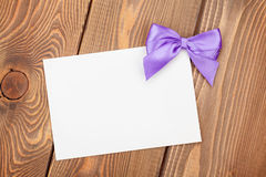 Greeting card with purple bow Stock Image