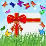 Greeting-card with a red bow and bright butterflies Royalty Free Stock Photo