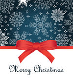 Greeting card with red bow on snowflakes background and copy space Stock Photo