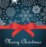 Greeting card with red bow on snowflakes background and copy space Stock Photography