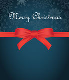 Greeting card with red bow on snowflakes background and copy space Stock Image