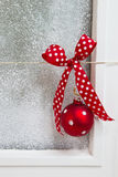 Greeting card with a red dotted ribbon on a white background. Christmas background for a greeting card Stock Photo