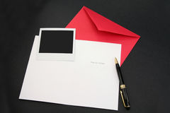 Greeting card and red envelope Stock Image