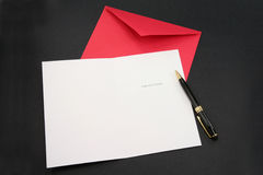 Greeting card and red envelope Stock Photo