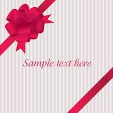 Greeting card with red satin bow Royalty Free Stock Photography