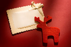 Greeting card and reindeer Stock Photography