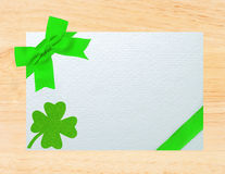 Greeting card for Saint Patrick's Day over wooden background Stock Photo