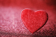 Greeting card on Saint Valentine day with red heart on glitter background. Stock Image