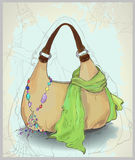 Greeting card with a scarf, a bag and costume jewe Stock Image