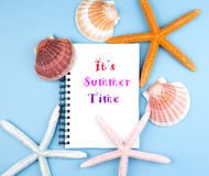 Greeting card with shells and starfishes and place for text Royalty Free Stock Image