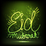 Greeting Card with Shiny Text for Eid Mubarak. Royalty Free Stock Photo
