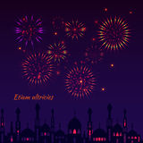 Greeting card with a silhouette of mosques and fireworks Royalty Free Stock Photography