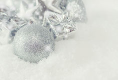Greeting card. Silver Christmas decorations. In snow with sparkles, copy space Stock Photo