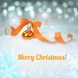 Greeting card with a single orange Christmas bauble Stock Photos
