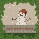 Greeting card with a snowman in a frame of fir branches Stock Image
