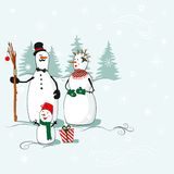 Greeting card with a snowmen Stock Photos