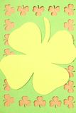 Greeting Card St. Patrick's Day. Background for St. Patrick's Day. Silhouettes of green clover stock photo