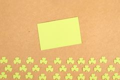 Greeting Card St. Patrick's Day. Background for St. Patrick's Day. Silhouettes of green clover royalty free stock image