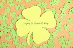 Greeting Card St. Patrick's Day. Background for St. Patrick's Day. Silhouettes of green clover royalty free stock images