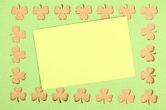 Greeting Card St. Patrick's Day. Background for St. Patrick's Day. Silhouettes of green clover stock image