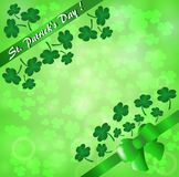 Greeting card for St. Patrick`s Day  on a green background of leaves of a clover. Greeting card for St. Patrick`s Day with a green ribbon and bow on a green Stock Photos