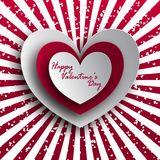 Greeting card for St. Valentine`s Day. Heart made of paper, origami, with a shadow. For design, for a declaration of love. Against the backdrop of red-white Stock Photography