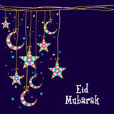 Greeting card with stars and moon for Eid Mubarak celebration. Stock Photos