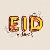 Greeting card with stylish text for Eid celebration. Elegant greeting card design with creative text Eid Mubarak on stylish background for famous festival of Royalty Free Stock Image