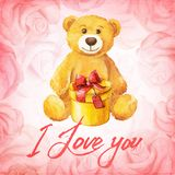 Greeting card. Teddy bear with a gift on a background of pink roses. Watercolor vector illustration. Stock Photos