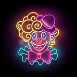 Greeting Card Template for April Fool`s Day, Happy Birthday Concept. Glow Signboard with Cute, Lovely Clown. Neon Light Poster, Flyer, Banner, Postcard. Glossy Stock Photo