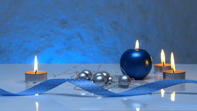 Greeting card template made of blue and tea candles, silver christmas balls, silver string of beads and blue ribbon in front Royalty Free Stock Image