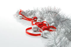 Greeting card template made of red ribbon, silver tinsel and balls with copy space, horizontal view, selective focus Royalty Free Stock Images
