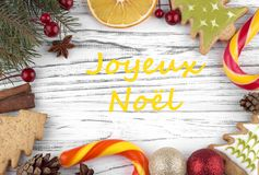 Greeting card with text Merry Christmas in French.  stock photo