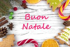 Greeting card with text Merry Christmas in Italian.  royalty free stock photography