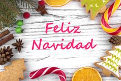 Greeting card with text Merry Christmas in Spanish.  stock photo