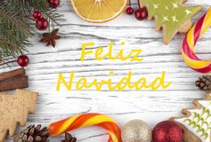 Greeting card with text Merry Christmas in Spanish.  stock images