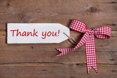 Greeting card with thank you and a red checked ribbod Stock Images