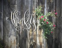 Greeting card - Thank You on wooden background. With small pink flowers Royalty Free Stock Image
