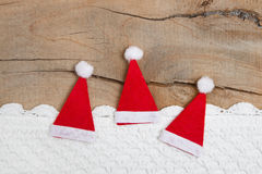 Greeting card of three Santa hat with crochet stri Royalty Free Stock Images