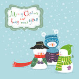 Greeting card with three snowmen Royalty Free Stock Image