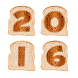 2016 greeting card on toasted slices of bread isolated on white Royalty Free Stock Image