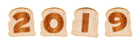 2019 greeting card on toasted slices of bread isolated on white. Background stock photos