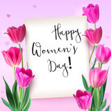 Greeting card with tulips around the sheet of paper with text on pink background. Realistic flowers tulips with petals. And leaves, festive composition Royalty Free Stock Images
